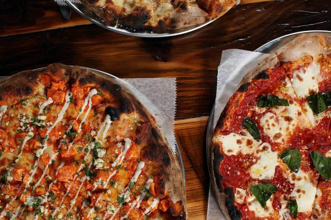 Marra Forni Rotator Brick Oven Client PizzaCo three pizzas