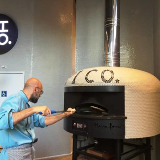 italian chef giulio adriani using Pi Co brick pizza oven